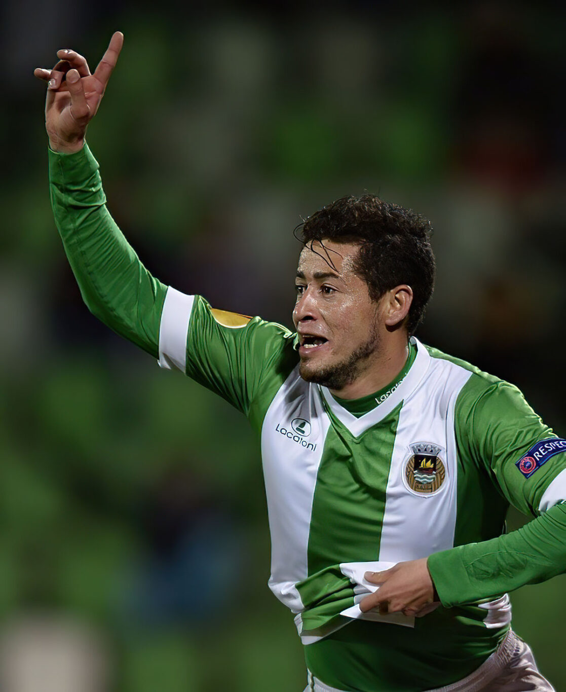 Rio Ave's Brazilian midfielder Diego Lopes celebrates after scoring during the UEFA Europa League football match Rio Ave FC vs FC Steaua Bucharest at the Arcos stadium in Vila do Conde on November 6, 2014.