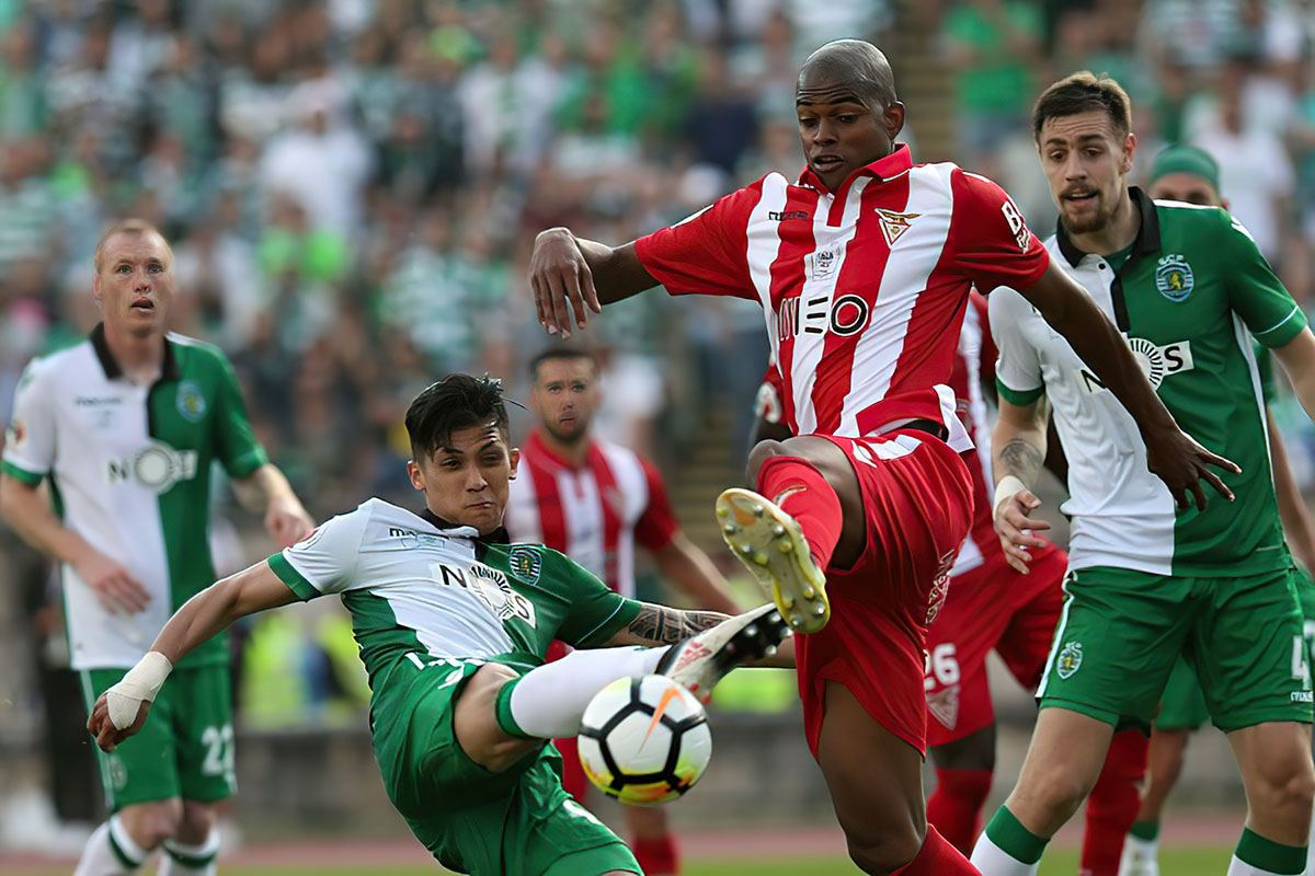 Sporting's forward Fredy Montero from Colombia (L) fights for the ball with Aves' defender Jorge Fellipe during the Portugal Cup Final football match CD Aves vs Sporting CP at the Jamor stadium in Oeiras, outskirts of Lisbon, on May 20, 2015.